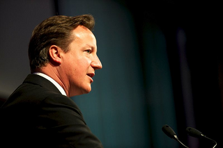 Cameron speaking at a conference, (https://commons.wikimedia.org/w/index.php?title=File:Prime_Minister_David_Cameron,_speaking_at_the_opening_of_the_GAVI_Alliance_immunisations_pledging_conference_2.jpg&oldid=153101579)